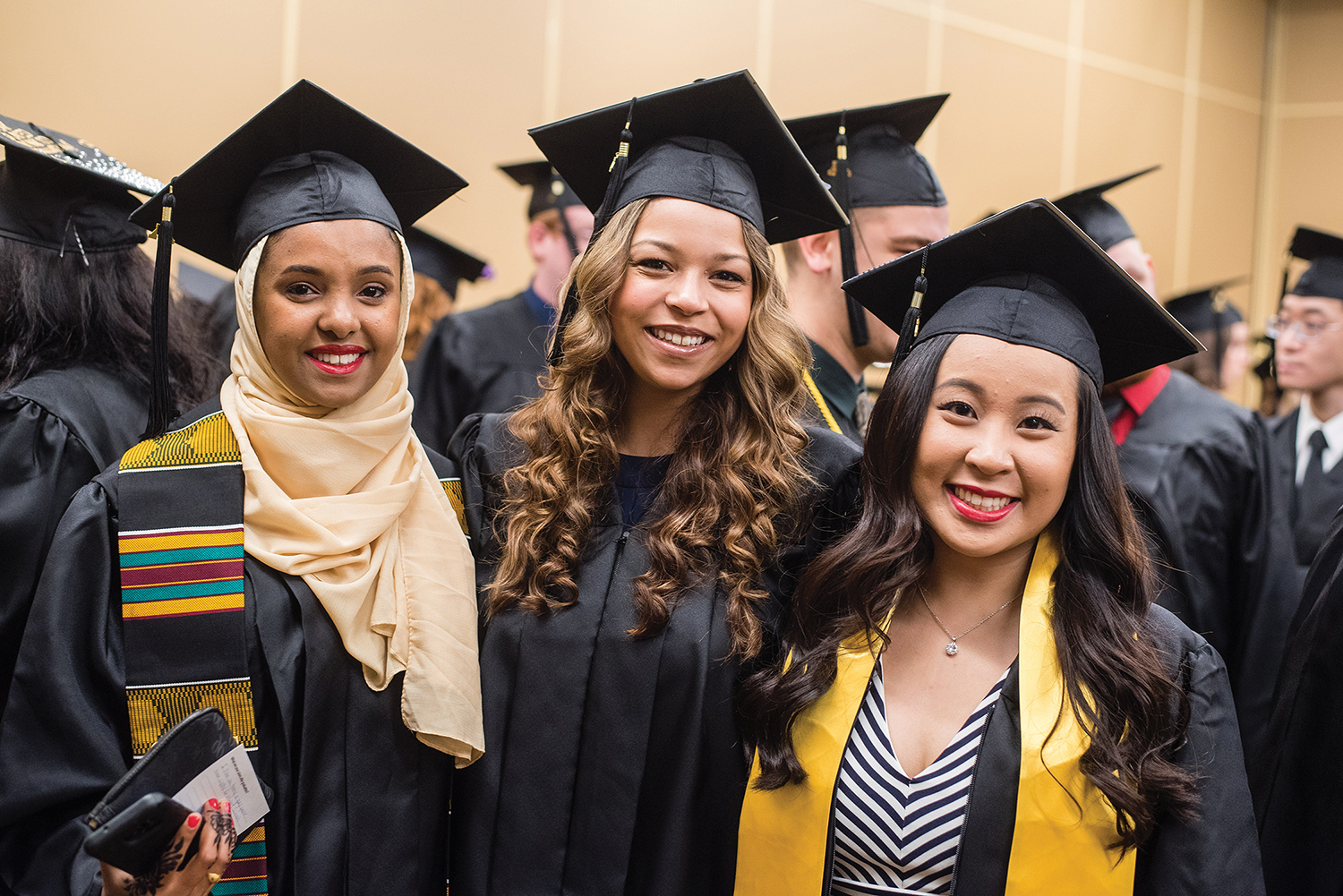 University of Minnesota Rochester graduates smiling after commencement