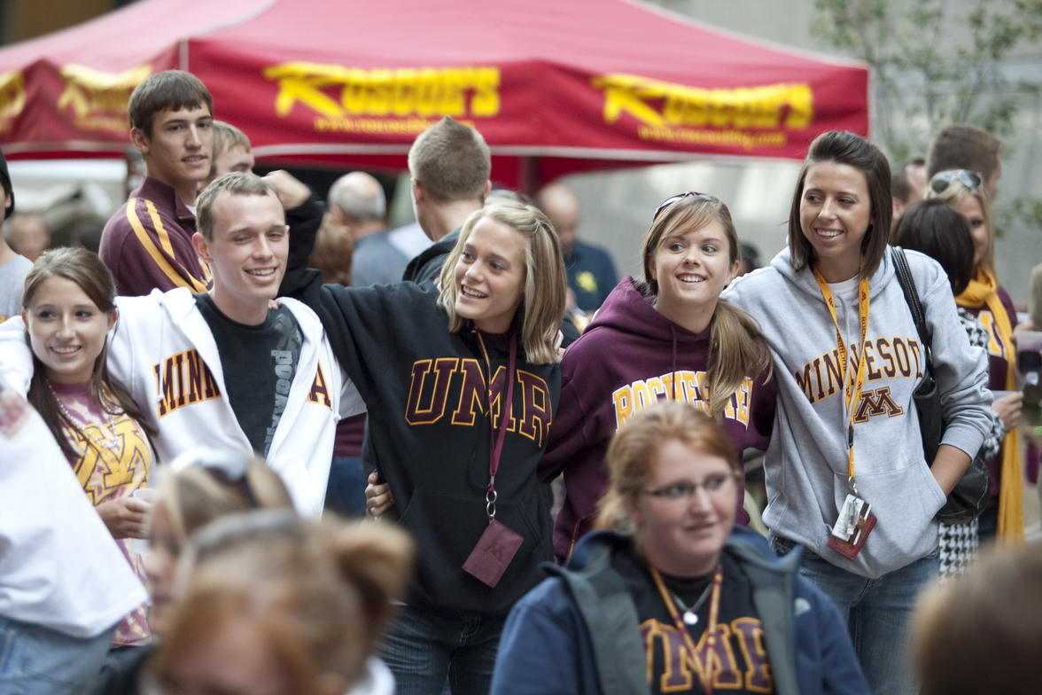 UMR students wearing University gear and having fun outside