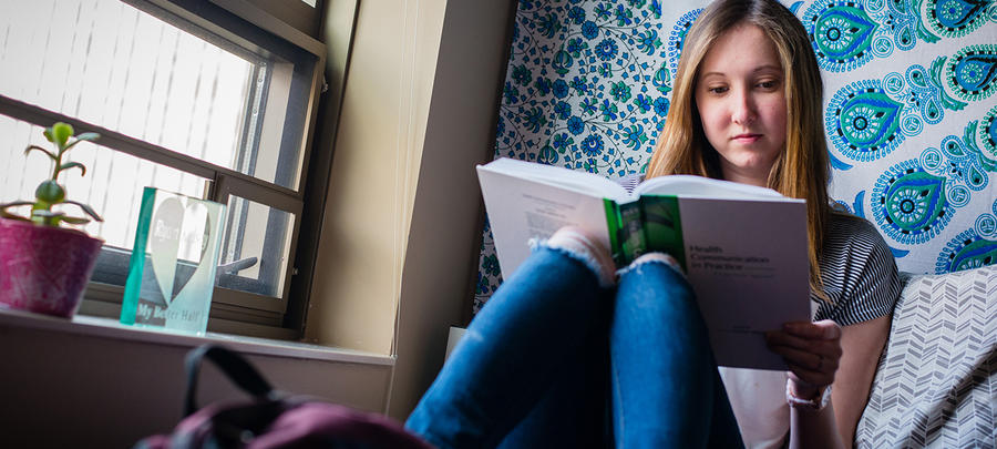 UMR student reading in her dorm room